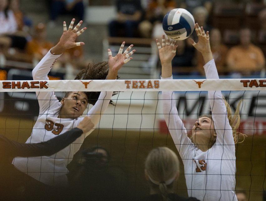 Texas Longhorns outside hitter LOGAN EGGLESTON (33) and middle blocker MOLLY PHILLIPS (15) during an NCAA volleyball game between Texas and Texas A&M at Gregory Gymnasium in Austin, Texas, on September 20, 2019.