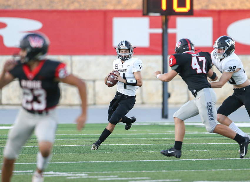 Vandegrift Vipers senior quarterback Dru Dawson (4) rolls out to pass during a high school football game between Vista Ridge and Vandegrift at Gupton Stadium in Cedar Park, Texas, on Sept. 27, 2019.