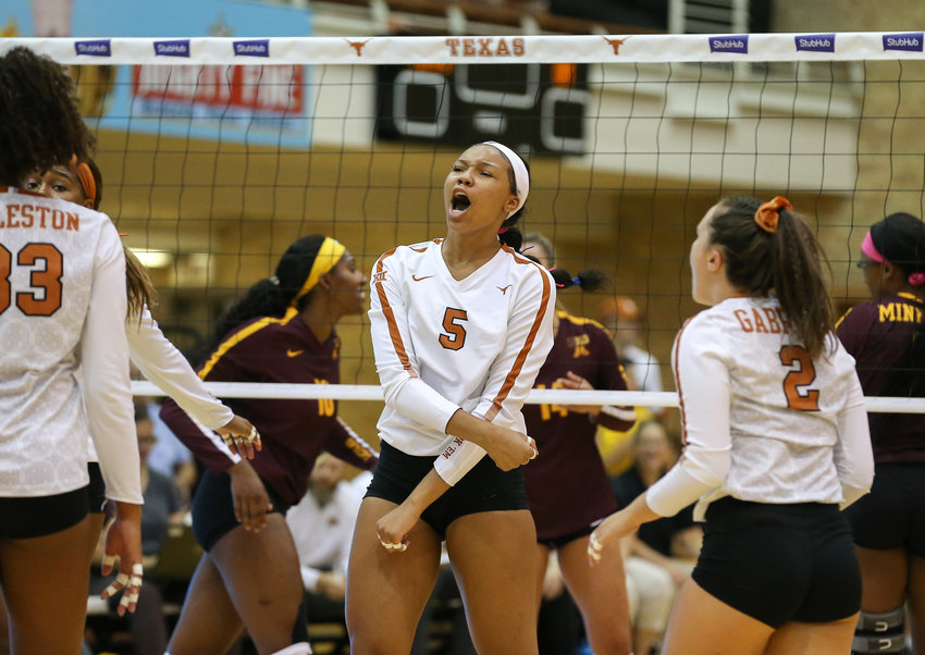 Texas Longhorns opposite side hitter SKYLAR FIELDS (5) celebrates a point during an NCAA volleyball match between Texas and Minnesota at Gregory Gymnasium in Austin, Texas on September 4, 2019.