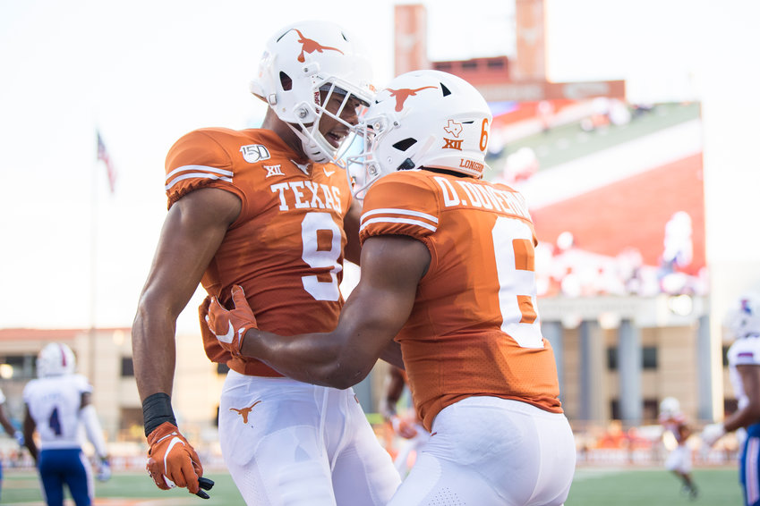 Collin Johnson, left, Devin Duvernay and the No. 11 Longhorns travel to Morgantown, West Virginia to face off with the Mountaineers on Saturday afternoon.