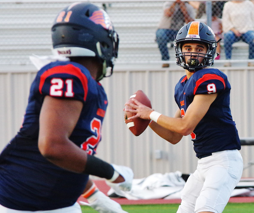 Glenn High School Grizzlies Quarterback Drew McGuire (9) prepares to pass to running back Julian Morris (21) against the Liberty Hill Panthers at Bible Stadium, Leander, Texas on August 30, 2019.