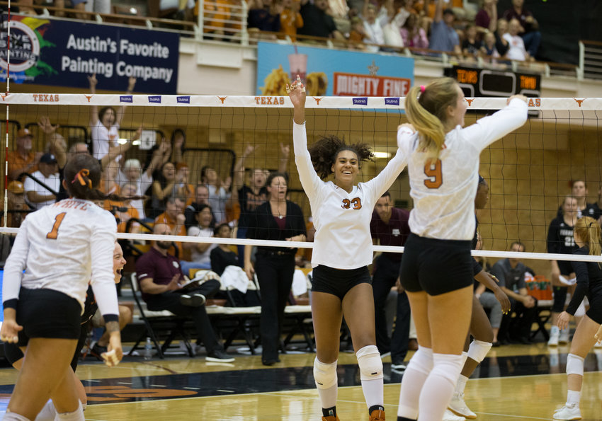 The Texas Longhorns celebrate a point during an NCAA volleyball game between Texas and Texas A&M at Gregory Gymnasium in Austin, Texas, on September 20, 2019.