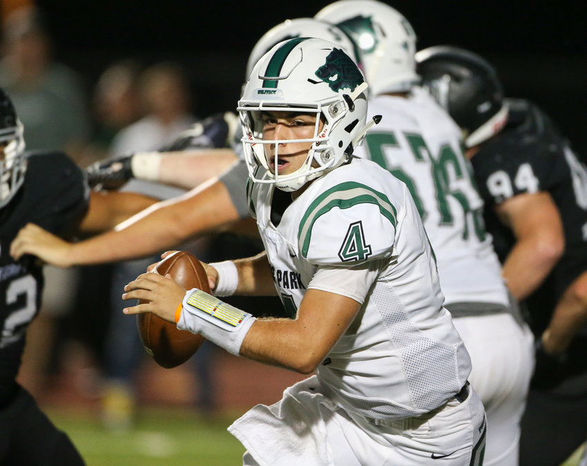 Cedar Park Timberwolves quarterback Ryder Hernandez scrambles in the backfield during a high school football game between Vandegrift and Cedar Park at Monroe Stadium in Austin, Texas on August 30, 2019.