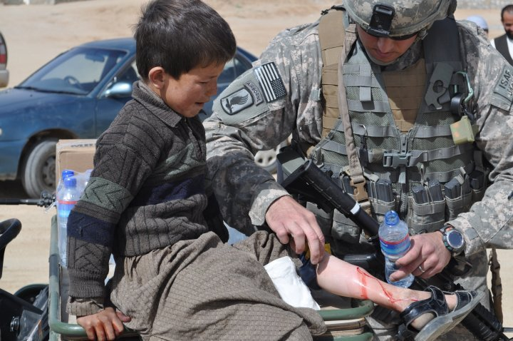 Cedar Park Council member Rodney Robinson helps treat a young boy's broken leg back in 2009 while serving in the Ghazni Province in Afghanistan.