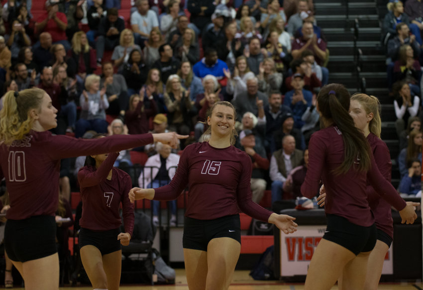 The Rouse Raiders celebrate a point during a high school volleyball playoff match between Rouse and Georgetown at Vista Ridge High School in Cedar Park, Texas, on Nov. 12, 2019.