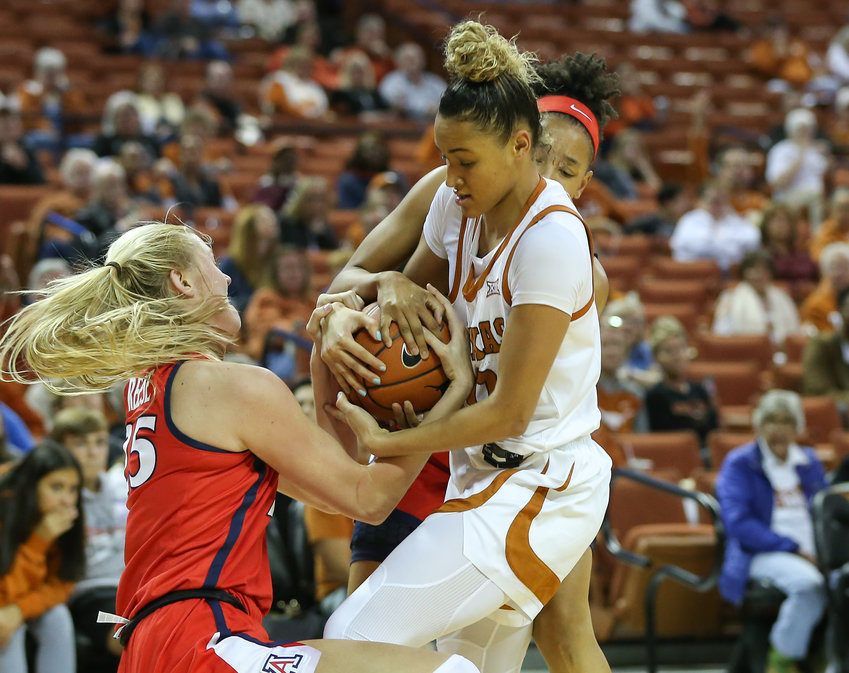 Texas Longhorns guard Celeste Taylor (0) battles with Arizona Wildcats forward Cate Reese (25) and guard Amari Carter (0) for possession during an NCAA women's basketball game between Texas and Arizona at Frank Erwin Center in Austin, Texas, on Nov. 17, 2019.