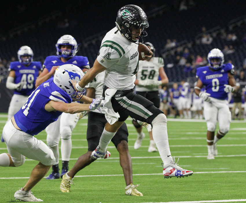Cedar Park Timberwolves junior quarterback Ryder Hernandez (4) high steps into the end zone for a touchdown in the third quarter of a high school football playoff game between Cedar Park and Friendswood at NRG Stadium in Houston, Texas, on Nov. 23, 2019.