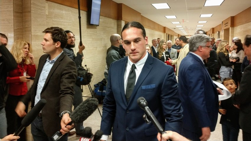 Former Leander High School football star Greg Kelley wiped back tears Wednesday morning in Williamson County District Court following his official exoneration from his 2014 conviction for super-aggravated sexual assault involving a child.
