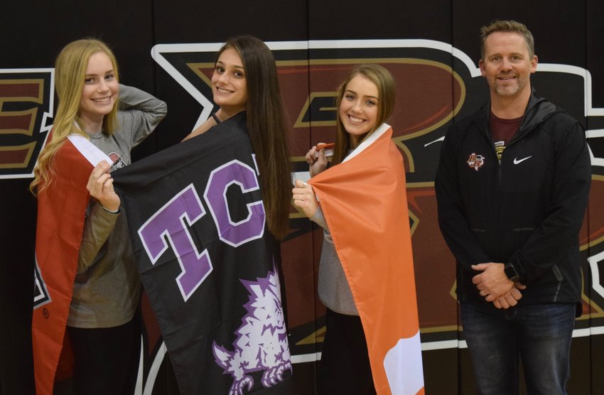 From right: Kara Erfurth (New Mexico), Grayson Schirpik (TCU), Reilly Heinrich (Texas) and Rouse volleyball coach Jacob Thompson at the Raiders' signing day ceremony.