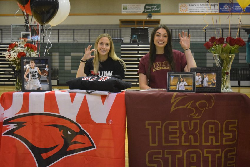 Cedar Park girls basketball players Hanna Wheeler, left, signed with Incarnate Word, and Nicole Leff signed with Texas State last week at a signing day ceremony.
