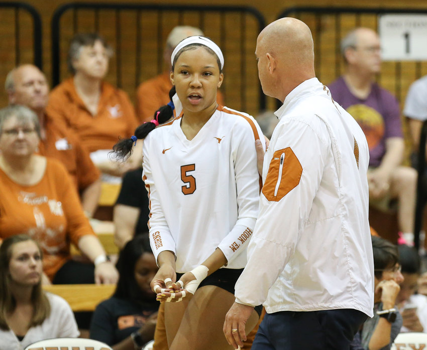 Texas Longhorns head coach Jerritt Elliott talks with Skylar Fields (5) during an NCAA volleyball match between the University of Texas and the University of Southern California at Gregory Gymnasium in Austin, Texas on September 1, 2019.