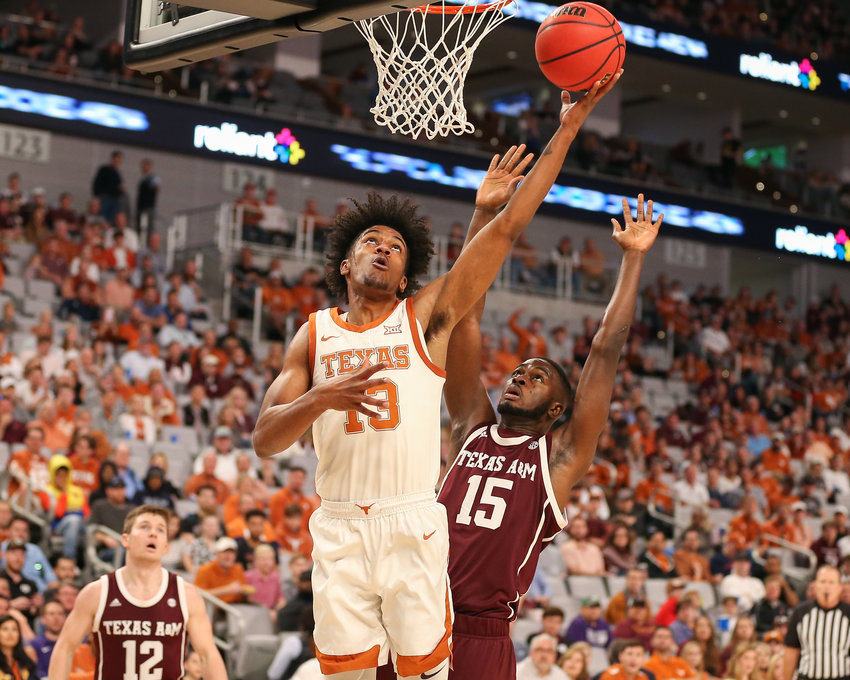 Texas Longhorns guard Jase Febres (13) goes to the basket during an NCAA men's basketball game between Texas and Texas A&M at Dickie's Arena in Fort Worth, Texas, on Dec. 8, 2019. Texas won, 60-50.
