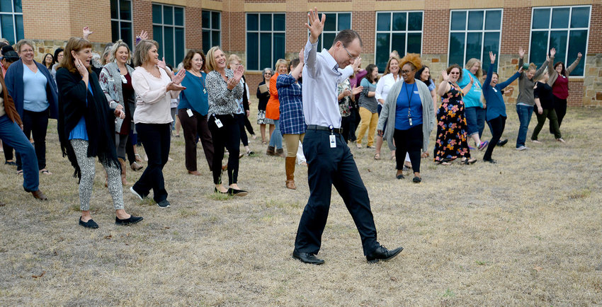 """Leander Independent School District Superintendent Dr. Bruce Gearing spent a Monday morning in October teaching LISD faculty a choreographed dance to the tune of """"Cotton Eye Joe."""""""