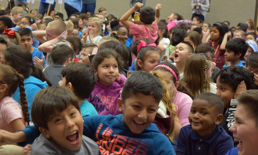 Students get excited after learning that they will be celebrating their Lighthouse Certification with cupcakes and extra recess.