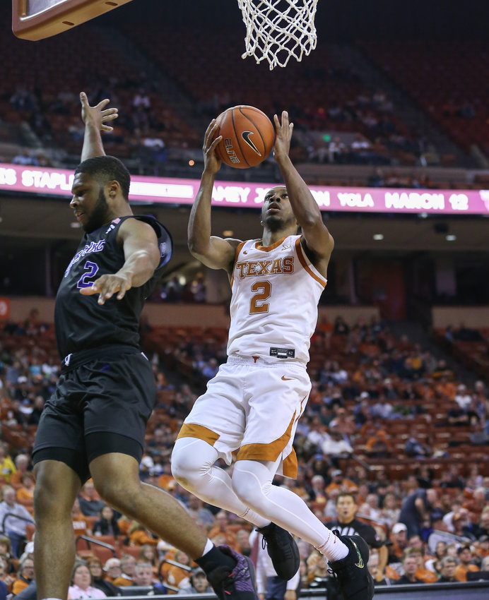 Texas Longhorns guard Matt Coleman III (2) goes to the basket as High Point Panthers guard Denny Slay II (2) overcommits on the defense during the second half of an NCAA men's basketball game between Texas and High Point in Austin, Texas, on Dec. 30, 2019.
