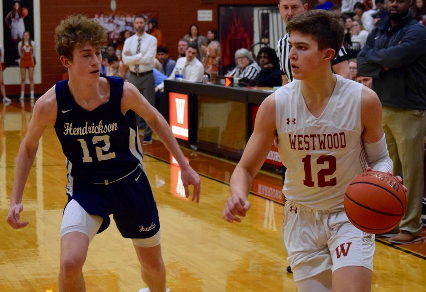 Sophomore Zach Engels, right, scored 12 points for Westwood, but the Warriors fell to Hendrickson 69-62 on Wednesday night.