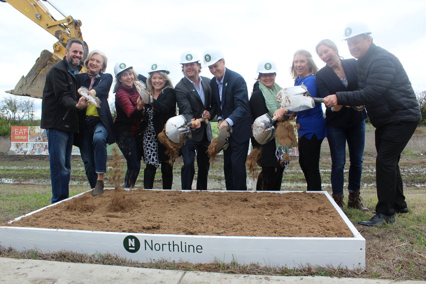 Northline owner Alex Tynberg (center, left) and Leander Mayor Troy Hill (center, right) celebrate with the Leander City Council on Wednesday, March 4, at the groundbreaking for the $715 million Northline development.