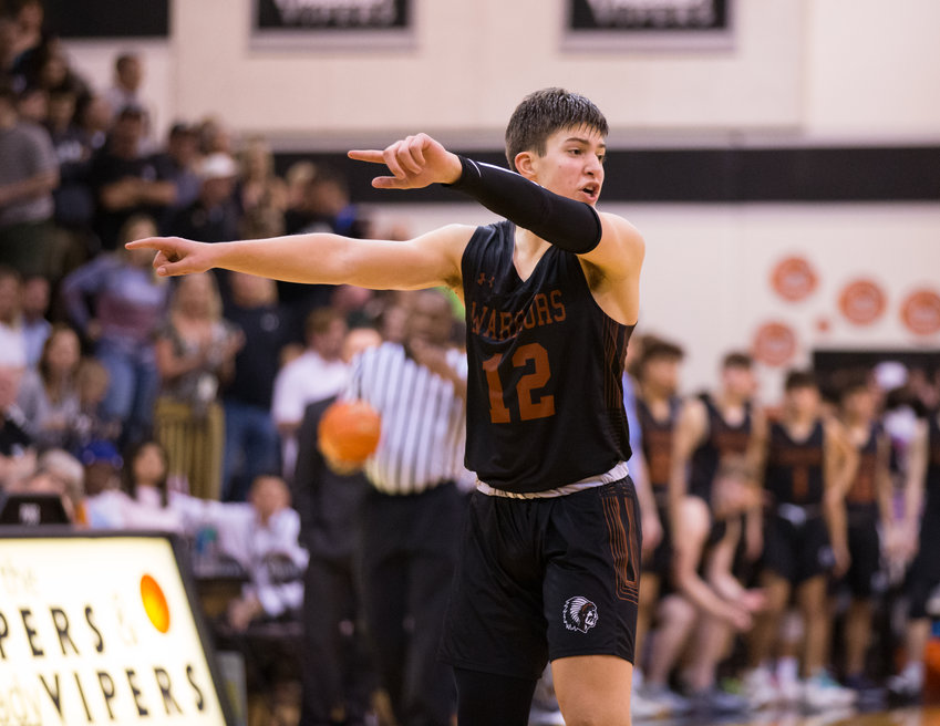 Westwood Warriors small forward Zach Engels (12) signals to his teammates during a high school boys basketball playoff game between Vandegrift and Westwood in Austin, Texas, on March 3, 2019.