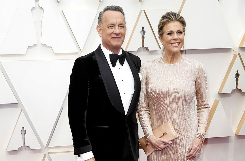 Tom Hanks and Rita Wilson arrive at the 92nd Academy Awards on Sunday, Feb. 9, 2020, at the Dolby Theatre at Hollywood & Highland Center in Hollywood.The couple announced Wednesday they have tested positive for the coronavirus. (Jay L. Clendenin/Los Angeles Times/TNS)