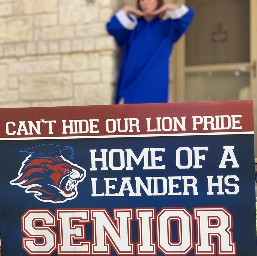 While some high schools have been selling yard signs for their Class of 2020, the Leander High School staff delivered a yard sign to every Leander High School senior for free on Friday.