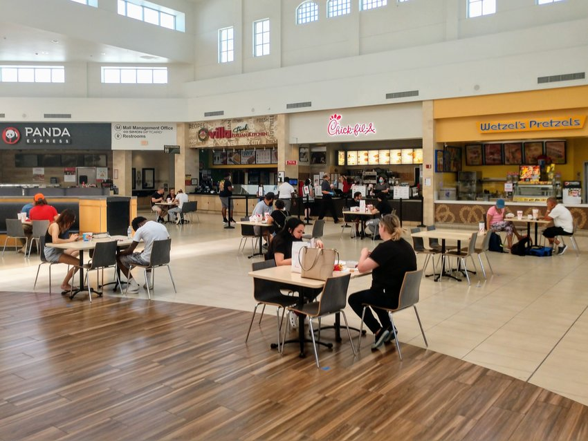Approximately 14 customers were seen eating in the newly reopened Lakeline Mall food court Friday afternoon despite Gov. Greg Abbott's reopening order explicitly prohibiting food courts in malls from being reopened.