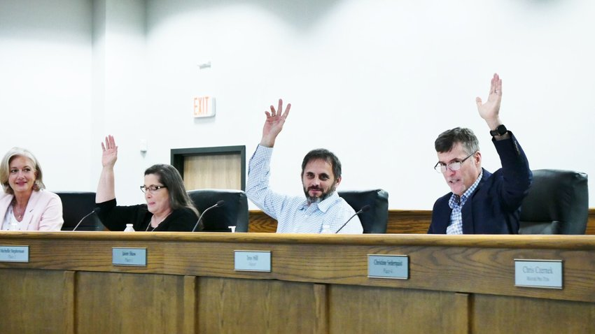 Six of the seven Leander City Council members and all attending city staff attended the May 7 Leander City Council meeting without wearing any face mask.
