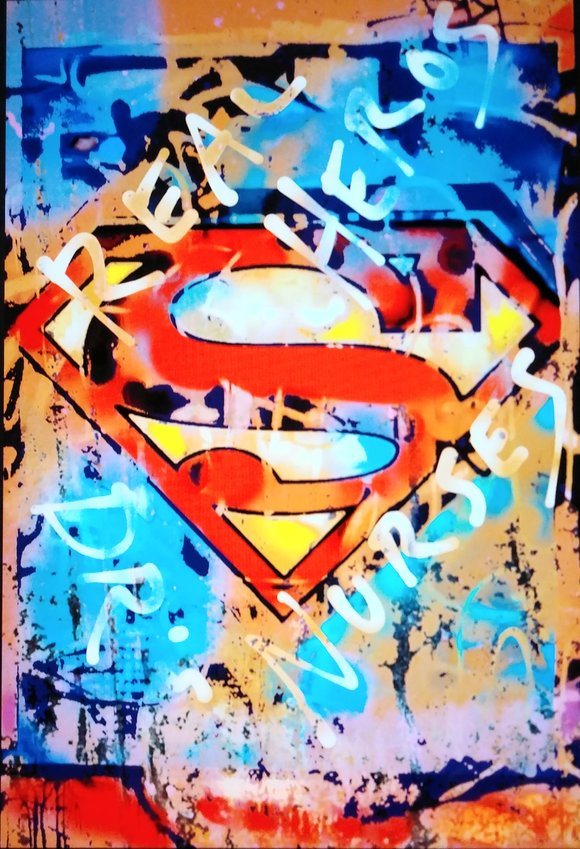 """Local artist Bill Whiting's """"The Real Heroes"""" is a graffiti art piece inspired by doctors and nurses."""