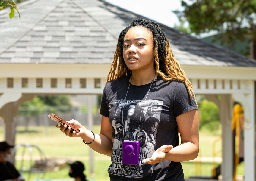 A former Leander High School student speaks to a group of about 60 people gather outside Quest Village Park in Cedar Park Monday, June 8, 2020, to peacefully protest racism and recent killings of black people at the hands of police.