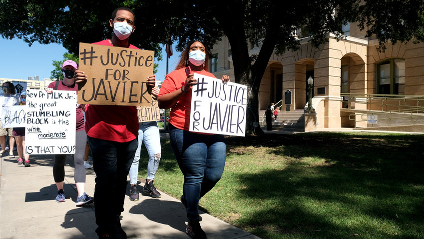 Kim Ambler-Jones (R), sister of Javier Ambler, and her husband, David Jones, led the march of about 40 people from the WilCo Sheriff's Office to the Williamson County Courthouse in Georgetown Saturday morning.