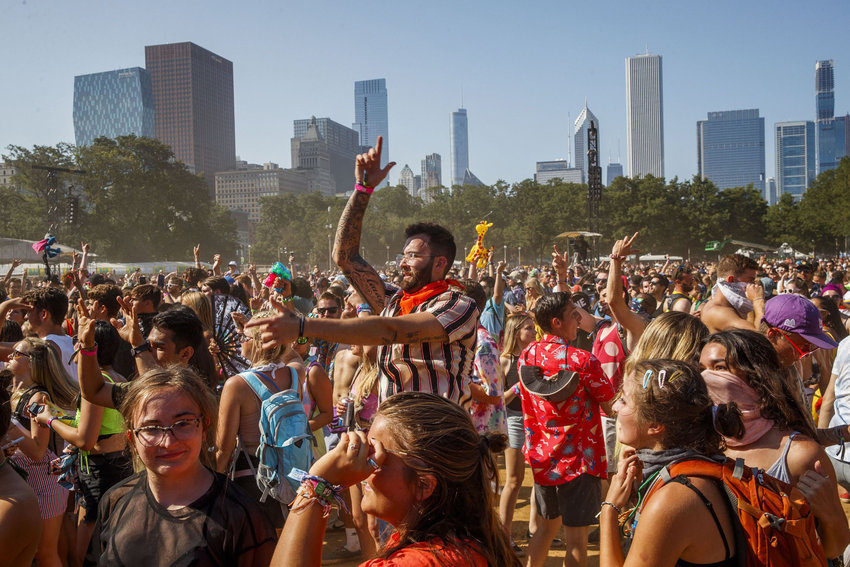 In this file photo, attendees dance at the Perry's stage during the last day of the 2019 Lollapalooza Music Festival in Grant Park Sunday Aug., 4, 2019, in Chicago. A free virtual version of Lollapalooza will take place on YouTube over the same weekend, July 30-August 2. (Armando L. Sanchez /Chicago Tribune/TNS)