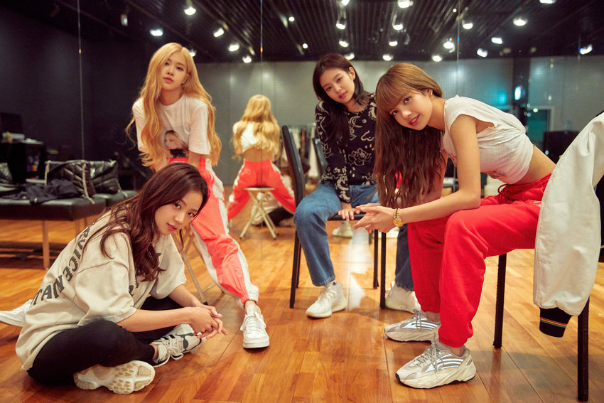 """Blackpink's Jisoo, clockwise from bottom left, Rose, Jennie and Lisa in """"Light Up the Sky."""" (Courtesy of YG/Netflix/TNS)"""