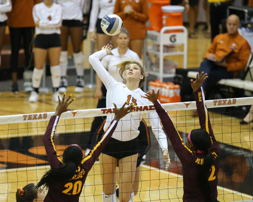 Texas Longhorns middle blocker Molly Phillips (15) during an NCAA volleyball match between Texas and Minnesota at Gregory Gymnasium in Austin, Texas on September 4, 2019.