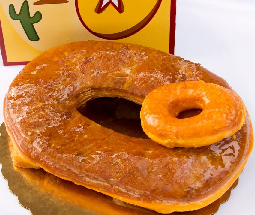 After nearly two decades, the orange-tined, sticky-frosting-covered Round Rock Donuts is finally coming to Cedar Park.