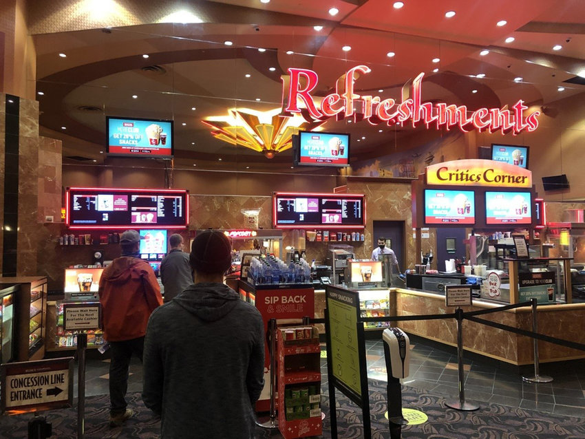 A handful of customers wait in line for refreshments at Cinemark Lincoln Square Cinemas in Bellevue, Washington. (Trevor Lenzmeier/The Seattle Times/TNS)