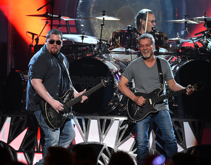 In this file photo, musicians Wolfgang Van Halen (L) and Eddie Van Halen of Van Halen perform onstage during the 2015 Billboard Music Awards at MGM Grand Garden Arena on May 17, 2015 in Las Vegas, Nevada.  (Ethan Miller/Getty Images/TNS)