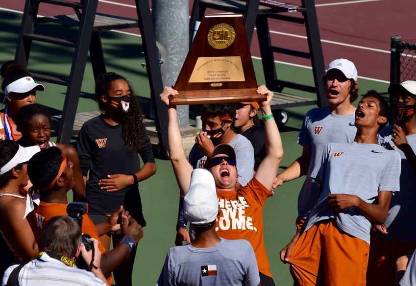 Head coach Travis Dalrymple celebrates after the Westwood tennis team won the state title for the second time in three seasons Tuesday in College Station.