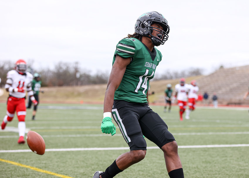 Cedar Park Timberwolves senior wide receiver Tristan Hervey (14) celebrates after scoring a touchdown during Cedar Park's 52-42 win in the Class 5A Div I Region 3 playoff win over Manvel  on January 1, 2021 in Bryan, Texas.