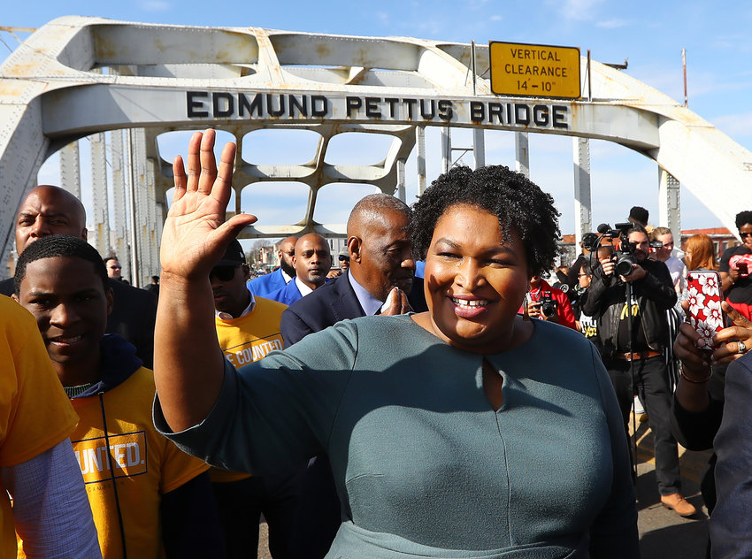 Former candidate for Georgia governor Stacey Abrams crosses the Edmund Pettus Bridge during Selma's re-enactment of Bloody Sunday on Sunday, March 1, 2020, in Selma, Ala. (Curtis Compton/Atlanta Journal-Constitution/TNS)