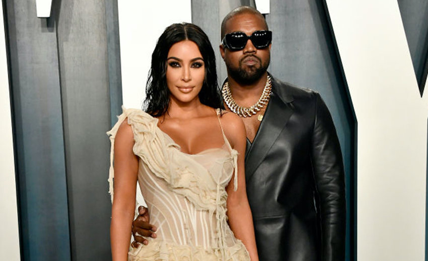From left to right: Kim Kardashian and Kanye West attend the 2020 Vanity Fair Oscar Party hosted by Radhika Jones at Wallis Annenberg Center for the Performing Arts on February 9, 2020 in Beverly Hills, California. (Photo by Frazer Harrison/Getty Images/TNS)