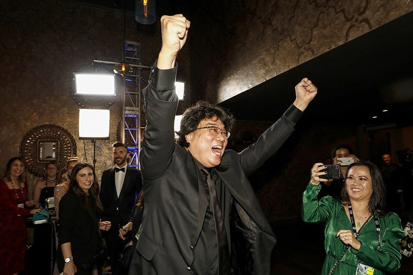 """""""Parasite"""" director Bong Joon Ho cheers his cast's landmark win, marking the first time in history that a foreign-language film has won the SAG Award for best ensemble. (Al Seib/Los Angeles Times/TNS)"""
