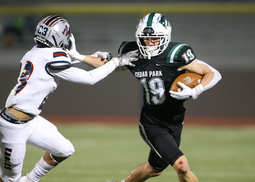 Cedar Park Timberwolves senior wide receiver Jack Hestera (19) delivers a stiff arm to Veterans Memorial Eagles cornerback Joseph Meador (23) during a high school football playoff game  between Cedar Park and Veterans Memorial on January 8, 2021 in San Antonio, Texas. The city of Cedar Park plans a parade through town to send the team off in style.