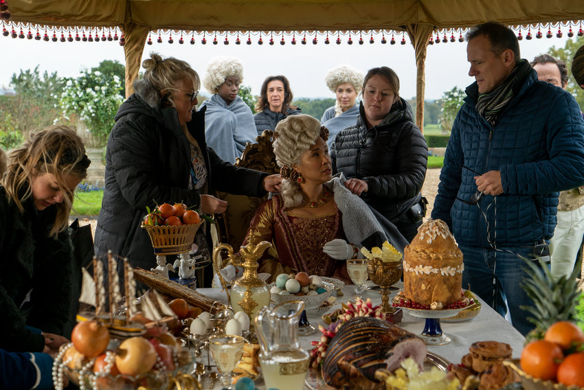 """Director Tom Verica (right) on the set of Netflix's """"Bridgerton"""" with Golda Rosheuvel (seated), who plays Queen Charlotte. (Liam Daniel/Netflix/TNS)"""