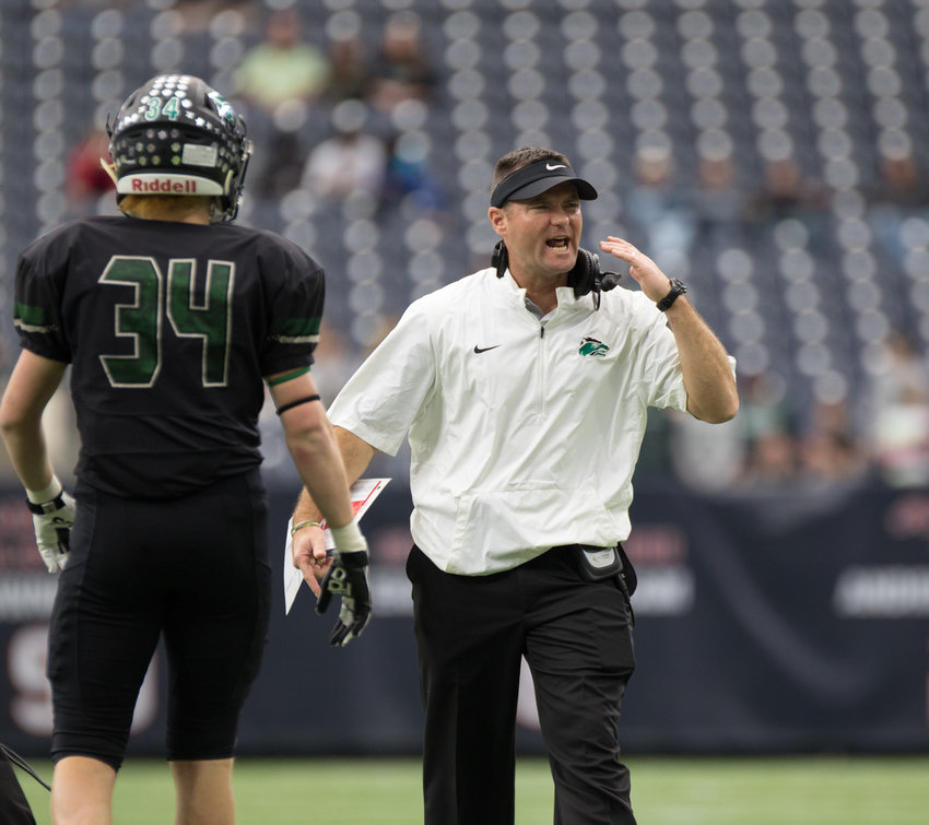 Cedar Park head coach Carl Abseck looks to get the attention of a game official after a flag during the Texas Class 5A, Division II football state championship game between Cedar Park and Frisco Lone Star, at NRG Stadium in Houston.