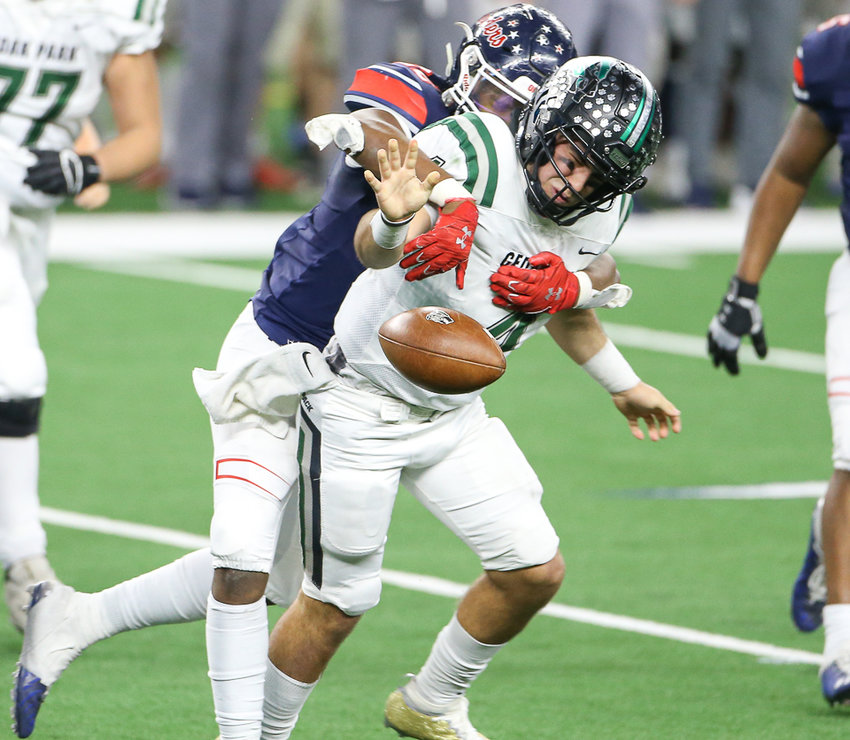 Cedar Park Timberwolves senior quarterback Ryder Hernandez (4) has the ball knocked away on a strip sack during the Class 5A Division I football state championship game between Cedar Park and Denton Ryan on January 15, 2021 in Arlington, Texas.