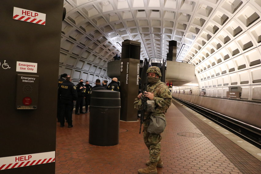 An armed soldier guards a Washington D.C. metro rail station near the National Mall on Jan. 20 during the presidential inauguration.