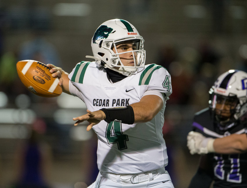Cedar Park Timberwolves senior quarterback Ryder Hernandez (4) drops back to pass during a high school football game between Cedar Ridge and Cedar Park at Kelly Reeves Stadium, on Friday, October 2, 2020.