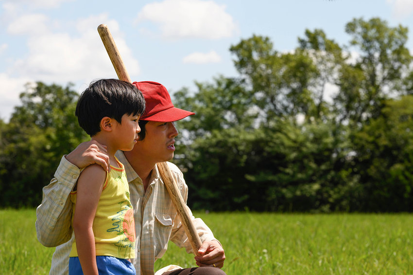 """Steven Yeun (right) appears in """"Minari"""" with Alan Kim by Lee Isaac Chung. (Courtesy of Sundance Institute/TNS)"""