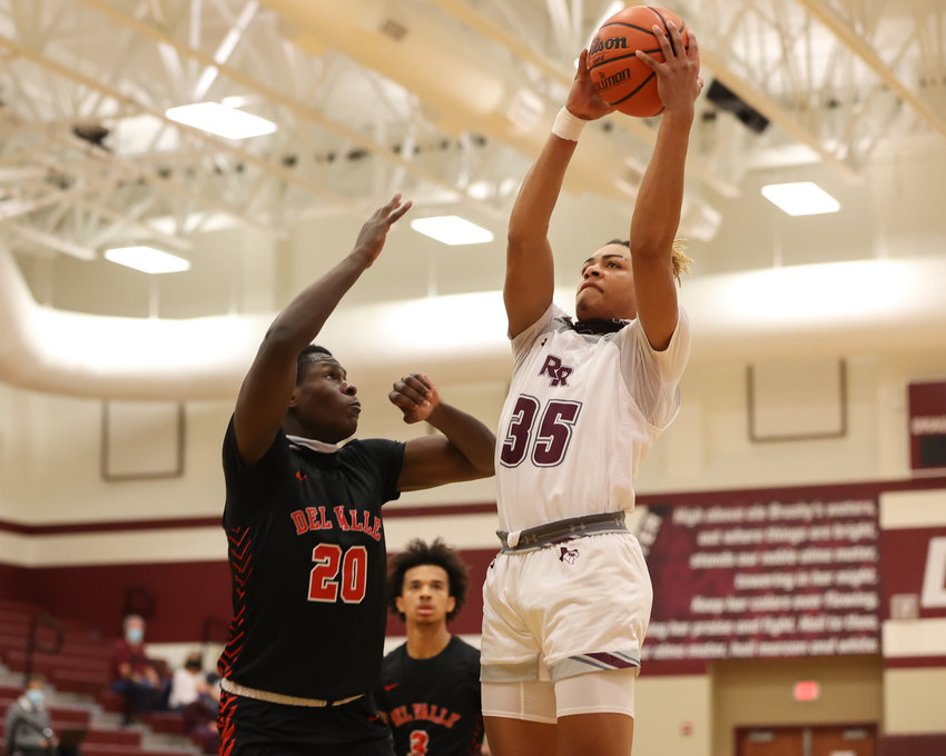 Round Rock Dragons senior center Larson Featherstone (35) grabs a rebound during a high school basketball playoff game between Round Rock and Del Valle on February 20, 2021 in Round Rock, Texas.