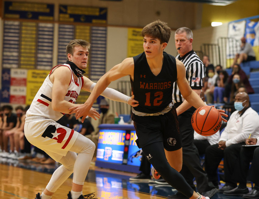 Westwood Warriors junior forward Zach Engels (12) moves the ball during a high school basketball playoff game between Bowie and Westwood on February 23, 2021 in Pflugerville, Texas.