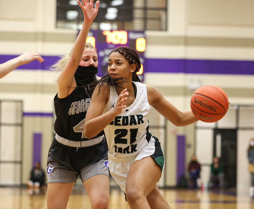 Cedar Park Timberwolves sophomore guard Gisella Maul (21) moves the ball during a high school girls basketball playoff game between Cedar Park and Georgetown on March 2, 2021 in Liberty Hill, Texas.